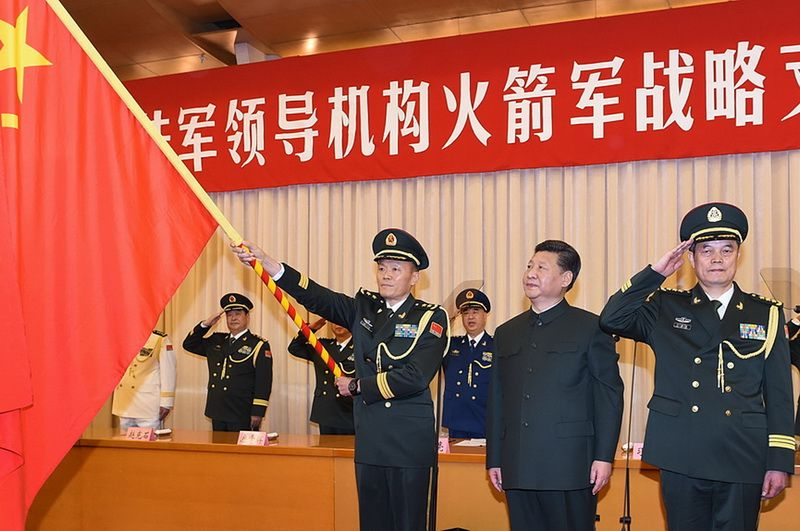 Chinese President Xi Jinping confers the military flag of the PLA's Strategic Support Force, Beijing, December 31, 2015
