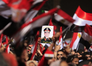Protesters in Tahrir Square with a portrait of the Minister of Defense Abdel Fattah al-Sisi
