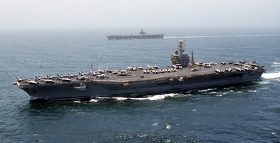 "CVN- 69 ""USS Dwight D. Eisenhower""  a striking nuclear aircraft carrier"