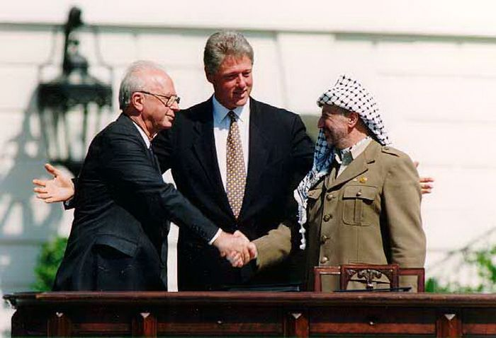 Israeli Prime Minister Yitzhak Rabin, U.S. President Bill Clinton, and leader of the PLO Yasser Arafat at the Oslo Accords signing ceremony, 13 September, 1993